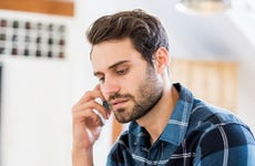 Concerned man talks on the phone